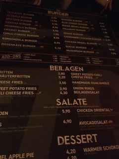 A menu of 73 Burger. Bar.